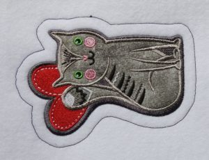 Photo of sewn iron-on patch outline stitch