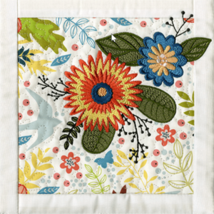 Photo of Anita Goodesign quilt block using printed fabric with embroidery