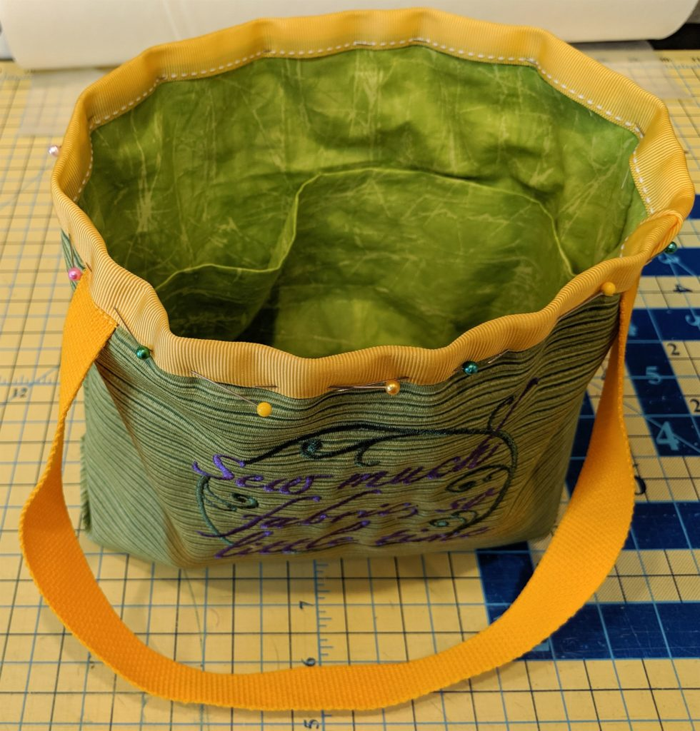 Photo of bag with ribbon binding showing the inside of the bag.