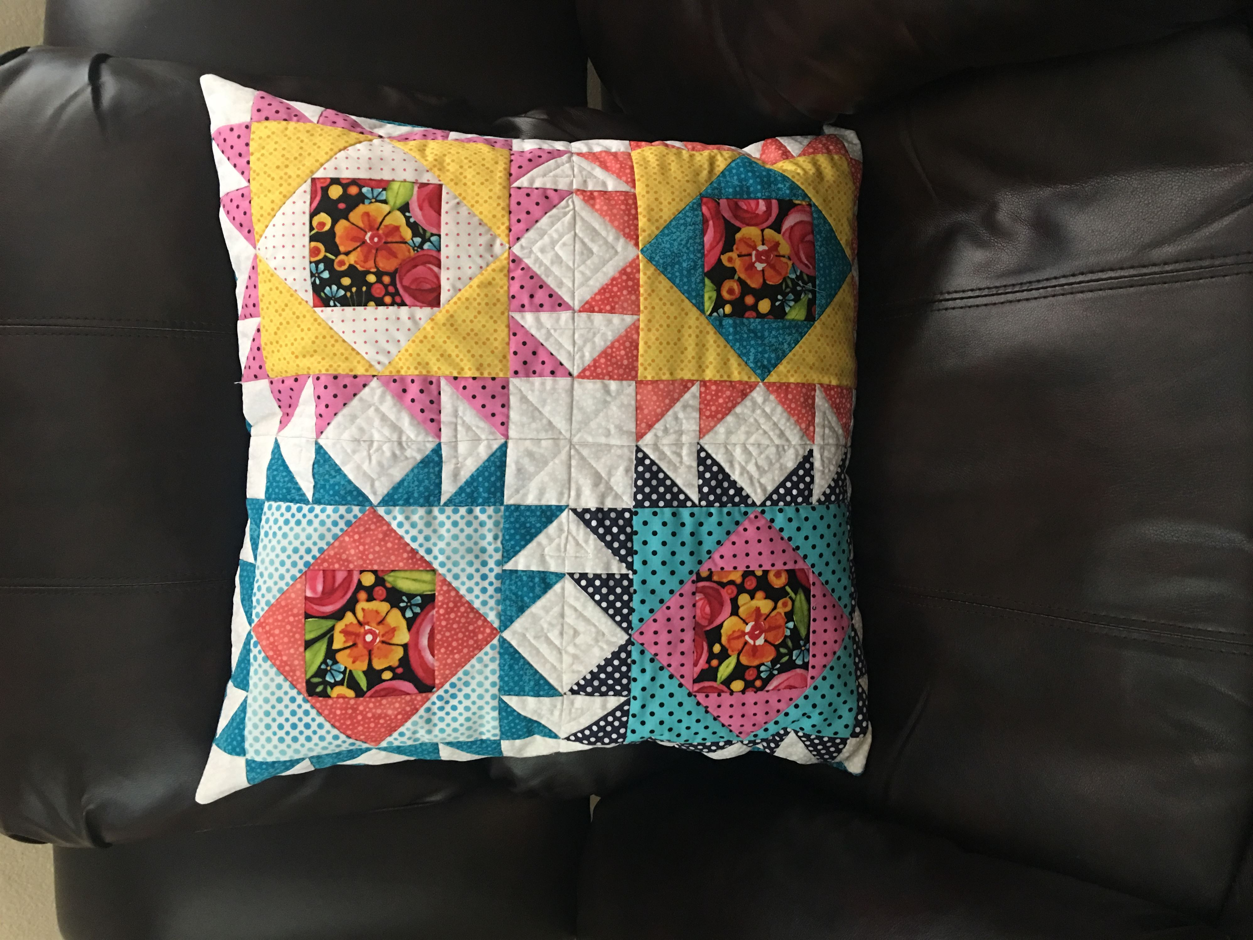 Photo of pillow made by paper piecing, one of in-store January events